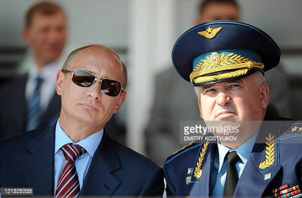 Russian Prime Minister Vladimir Putin and CommanderinChief of the Russian Air Force Alexander Zelin watch an air show during MAKS2011 the...