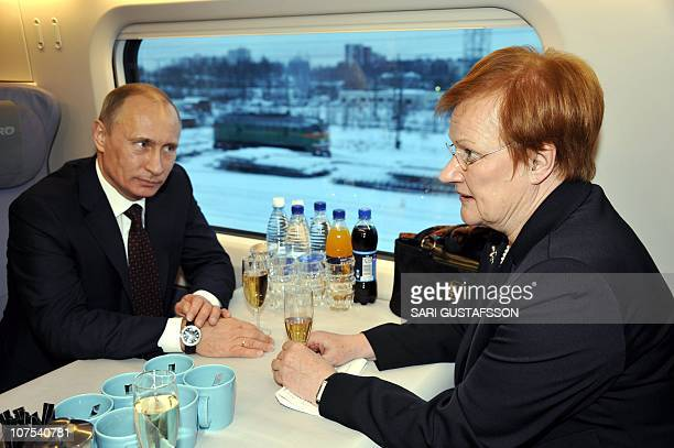 Russian Prime Minister Vladimir Putin and Finnish President Tarja Halonen confer aboard the Allegro speed train at railway station in Vyborg on...