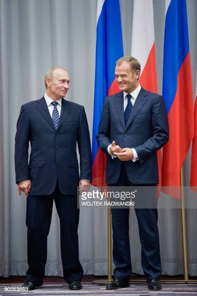 Russian Prime Minister Vladimir Putin and his Polish counterpart Donald Tusk smile during a joint press conference after their meeting in Gdansk on...