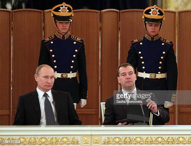 Russian Prime Minister Vladimir Putin and President Dmitry Medvedev attend the session of the State Council in Kremlin December 26 2011 in Moscow...