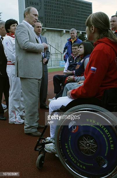 Russian Prime Minister Vladimir Putin and Sports Minister Vitaly Mutko meet Paralympic athletes in the Russian Black Sea resort of Sochi on December...