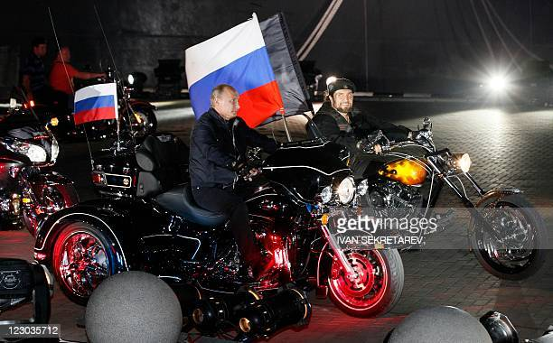 Russian Prime Minister Vladimir Putin and the leader of the Night Wolves biker group Alexander Zaldostanov also known as the Surgeon ride motorcycles...
