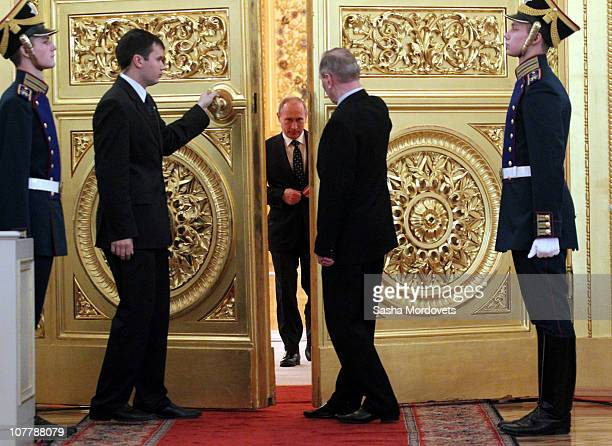 Russian Prime Minister Vladimir Putin enters the doors as he arrives to the meeting with regional governors at the Council of State in Moscow's Grand...