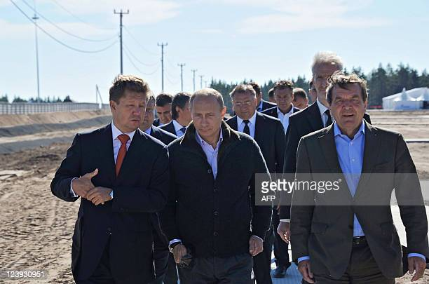 Russian Prime Minister Vladimir Putin Gazprom Chief Executive Officer Alexei Miller and former German chancellor Gerhard Schroeder arrive for the...