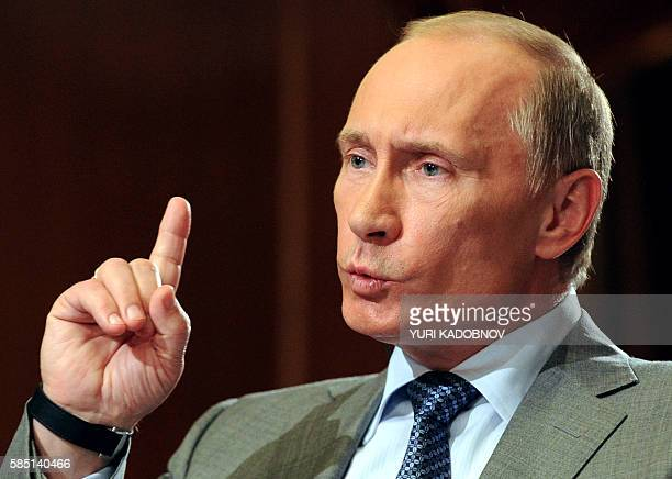 Russian Prime Minister Vladimir Putin gestures while speaking during an interview with major French media outlets Agence FrancePresse and France 2...