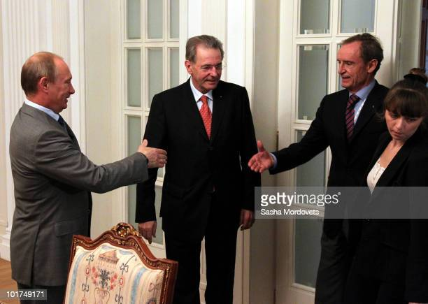 Russian Prime Minister Vladimir Putin International Olympic Committee chief Jacques Rogge and JeanClaude Killy chairman of the Sochi2014...