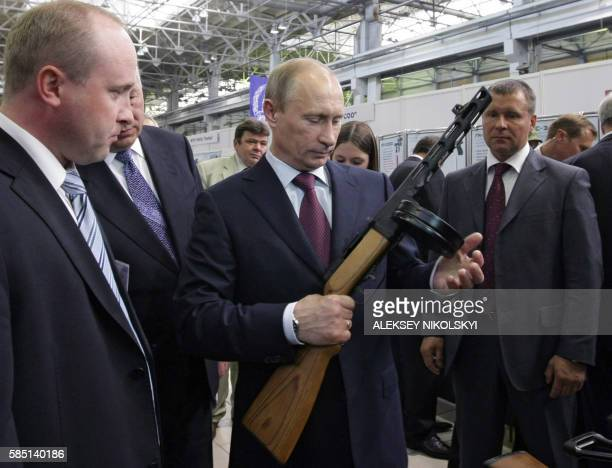 Russian Prime Minister Vladimir Putin listens to explanations as he visits IZHMASH Izhevsk Mechanical Works a weapons manufacturer in Izhevsk on May...