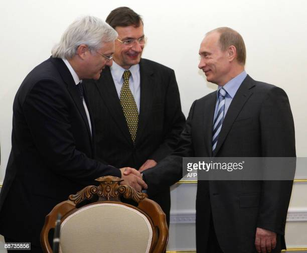 Russian Prime Minister Vladimir Putin meets with Royal Dutch Shell Chief Executive Jeroen van der Veer and Shell's incoming Chief Executive Peter...