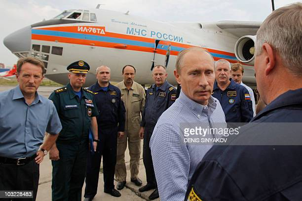 Russian Prime Minister Vladimir Putin meets with Russian Rescue Ministry pilots at an airport in Voronezh on August 4 2010 A heatwave has engulfed...