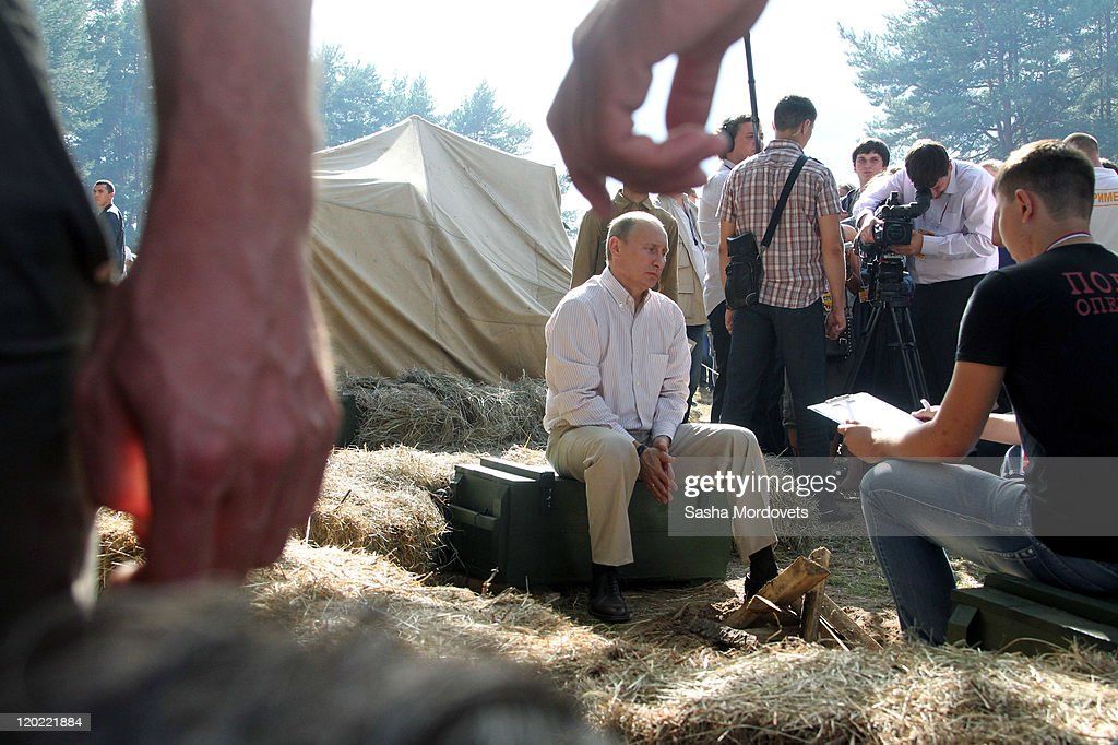 Russian Prime Minister Vladimir Putin meets with the media at the Seliger educational youth forum August 1, 2011 at Lake Seliger, Tver Region, Russia, on August, 1, 2011. Putin commented on the unification of Russia and Belarus stating that it fully depends 'on the will of the Belarusian people.'