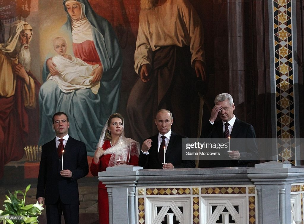 Putin And Medvedev Attend Easter Service : News Photo