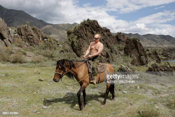 Russian Prime Minister Vladimir Putin rides a horse during his vacation outside the town of Kyzyl in Southern Siberia on August 3, 2009. AFP PHOTO /...