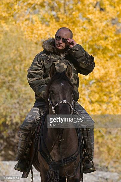 Russian Prime Minister Vladimir Putin rides a horse during his trip in Ubsunur Hollow Biosphere Reserve in Tuva Republic in this undated picture...