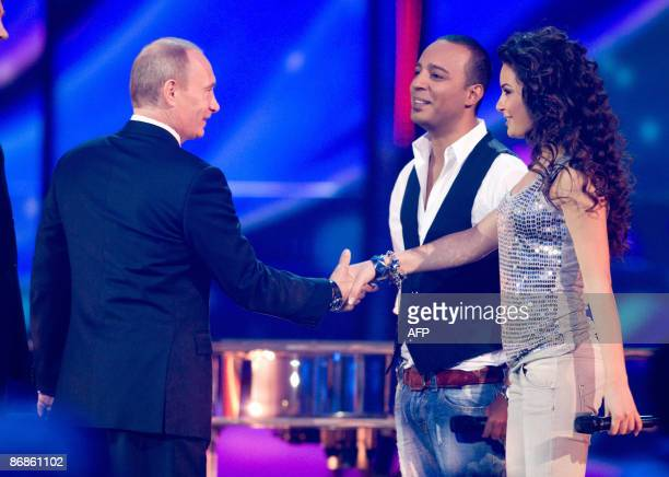 Russian Prime Minister Vladimir Putin shakes hands with Azerbaijan's entry into the 2009 Eurovision song contest AySel and Arash during rehearals in...