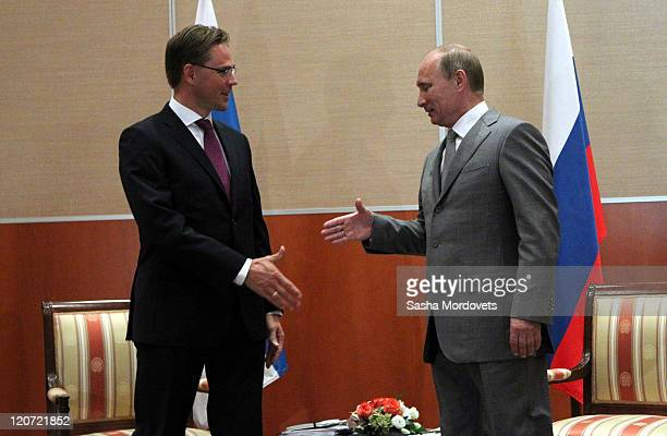 Russian Prime Minister Vladimir Putin shakes hands with Finland's Prime Minister Jyrki Katainen on August 9 2011 in Sochi Russia On the first day of...