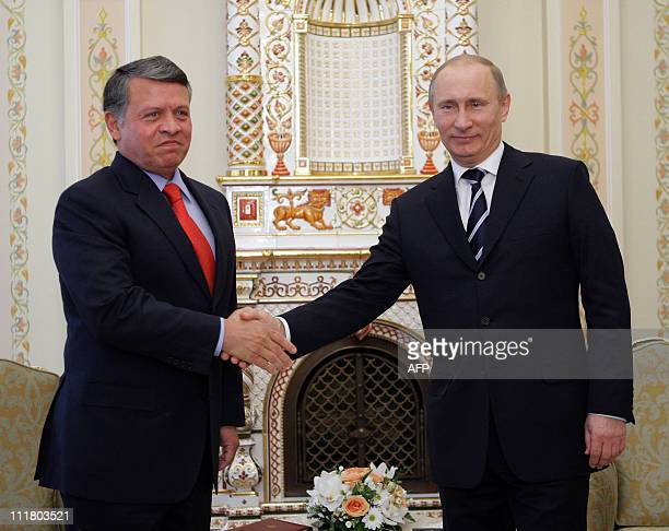 Russian Prime Minister Vladimir Putin shakes hands with Jordan's King Abdullah II at the NovoOgaryovo residence outside of Moscow on April 7 2011 AFP...