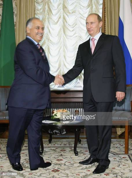 Russian Prime Minister Vladimir Putin shakes hands with Libyan Prime Minister Baghdadi Mahmudi in Moscow on July 31, 2008. Libya is negotiating with...