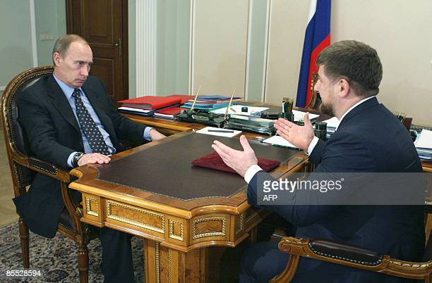 Russian Prime Minister Vladimir Putin speaks with head of Russia's Chechnya region Ramzan Kadyrov outside Moscow in Novo-Ogarevo on March 20, 2009....
