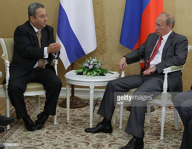 Russian Prime Minister Vladimir Putin speaks with Israeli Defence Minister Ehud Barak as they meet in Sochi on September 6 2010 Russia and Israel...