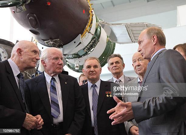 Russian Prime Minister Vladimir Putin speaks with US astronauts Thomas Stafford and Vance Brand and Russian cosmonauts Valery Kubasov and Alexei...
