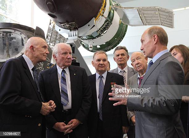 Russian Prime Minister Vladimir Putin speaks with US astronauts Thomas Stafford and Vance Brand and Russian cosmonauts Valery Kubasov and Alexei...