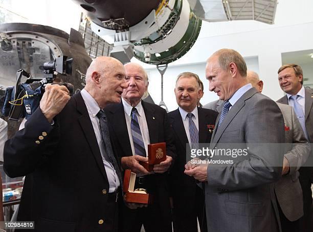 Russian Prime Minister Vladimir Putin speaks with US astronauts Thomas Stafford Vance Brand and Russian cosmonaut Valery Kubasov on July 19 2010 in...
