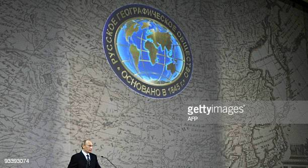 Russian Prime Minister Vladimir Putin stands under a giant map of Russia in Moscow on November 18 2009 while delivering a speech to members of the...