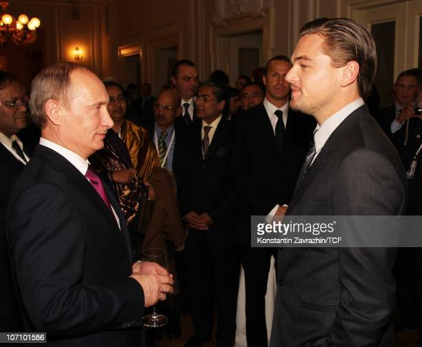 Russian Prime Minister Vladimir Putin talks with actor Leonardo DiCaprio during a reception held during the International Tiger Conservation Forum on...