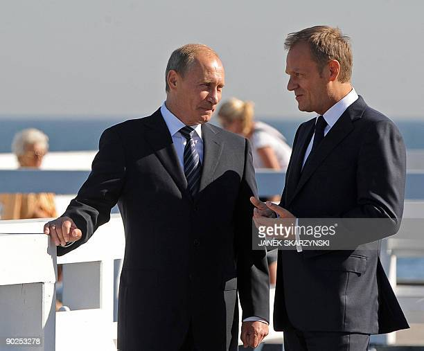 Russian Prime Minister Vladimir Putin talks with his Polish counterpart Donald Tusk on a pier in Sopot, on the northern coast of Poland, on September...