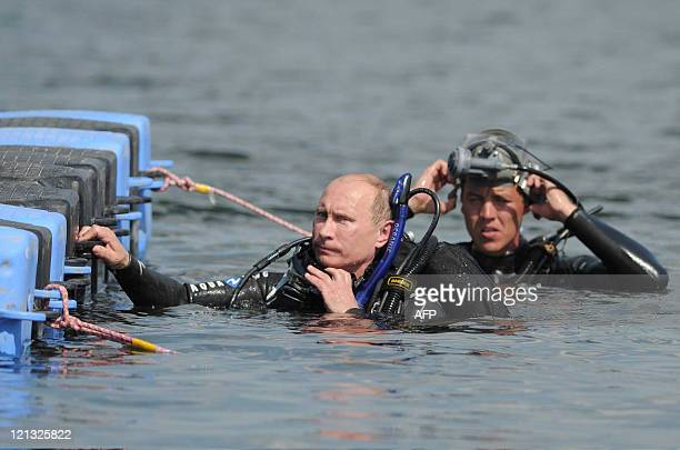 Russian Prime Minister Vladimir Putin visits an underwater archaeological site at Phanagoria on the Taman Peninsula on August 10 2011 Russia's hard...