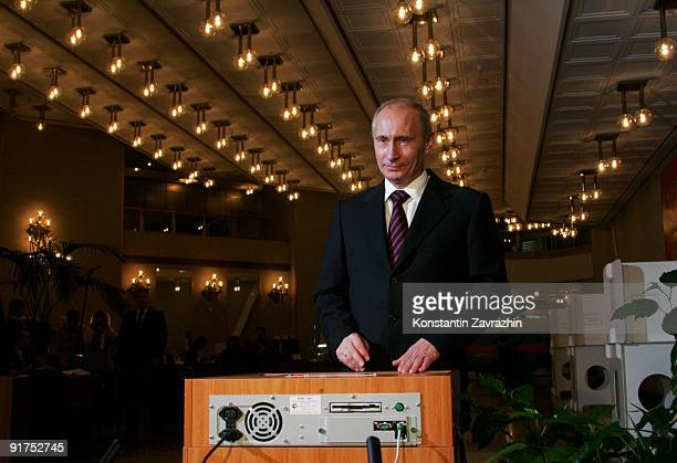 Russian Prime Minister Vladimir Putin votes at a polling station during municipal elections on October 11 2009 in Moscow Russia Millions of Russians...