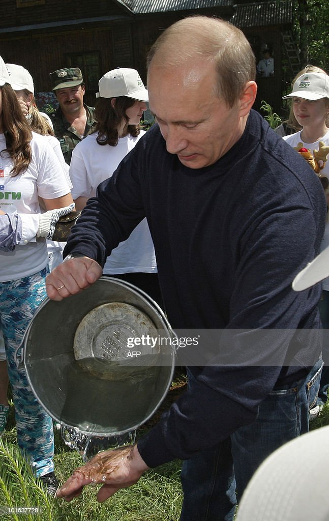 Russian Prime Ministers Vladimir Putin rinces his hands after planting a tree on June 5, 2010 during a visit to the Moose Island National Park in Moscow on the eve of World Environment Day.