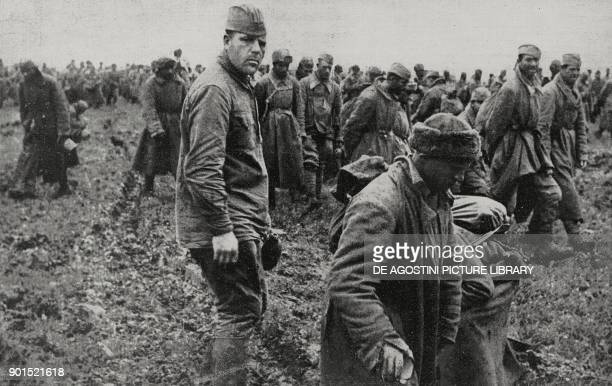 Russian prisoners in a prison camp after the defeat at Kharkov Ukraine World War II from L'Illustrazione Italiana Year LXIX No 23 June 7 1942