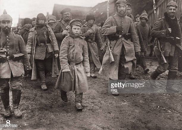 Russian prisoners of war being marched into captivity by their German captors on the Eastern Front during World War I circa 1916 The prisoners...