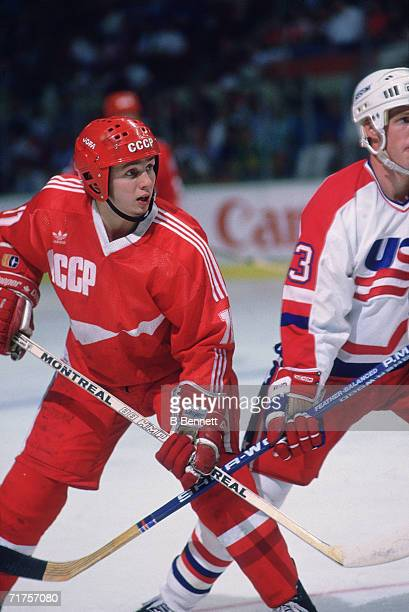 Russian professional hockey player Igor Larionov center for CSKA Moscow and on the ice as a member of Team USSR clashes sticks with an opposing...