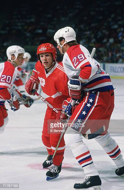 Russian professional hockey player Igor Larionov center for CSKA Moscow and on the ice as a member of Team USSR battles American hockey player Joel...