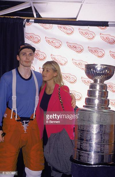 Russian professional hockey player Sergei Fedorov of the Detroit Red Wings has one hand on his girlfriend Russian tennis player Anna Kournikova and a...