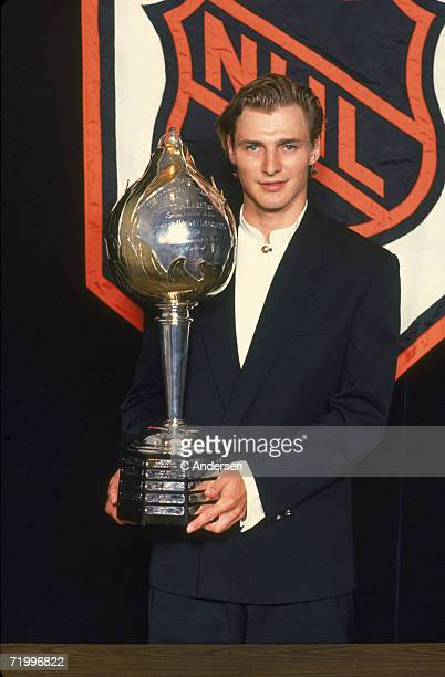 Russian professional ice hockey player Sergei Fedorov holds up the Hart Memorial Trophy given to the League's Most Valuable Player at the NHL awards...