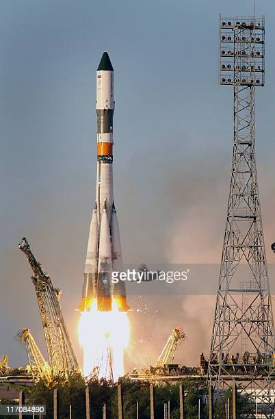 A Russian Progress M11M rocket blasts off from a Russian leased Kazakh Baikonur cosmodrome to the International Space Station on June 21 2011 It is...