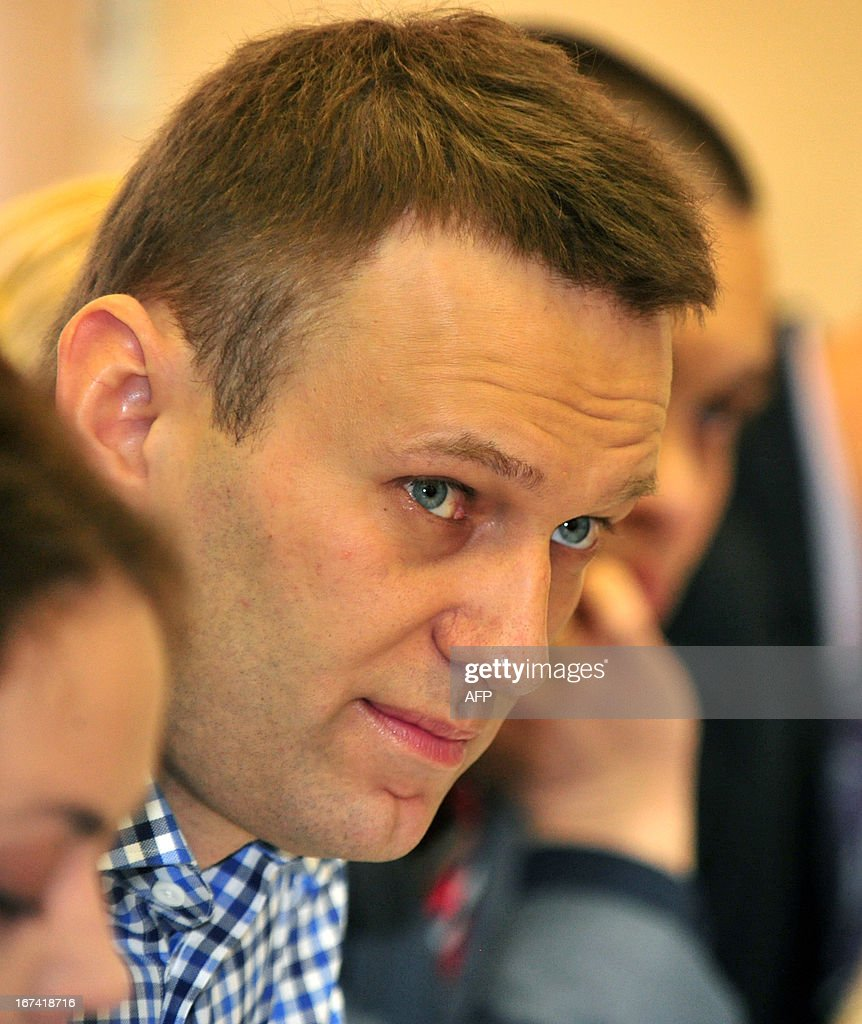 Russian protest leader Alexei Navalny looks as he attends the hearing of his case in a court in the provincial northern city of Kirov, on April 25, 2013. A Russian court in Kirov reopened yesterday the trial of opposition leader Alexei Navalny, who is accused of embezzlement and may face up to a decade in jail if convicted.