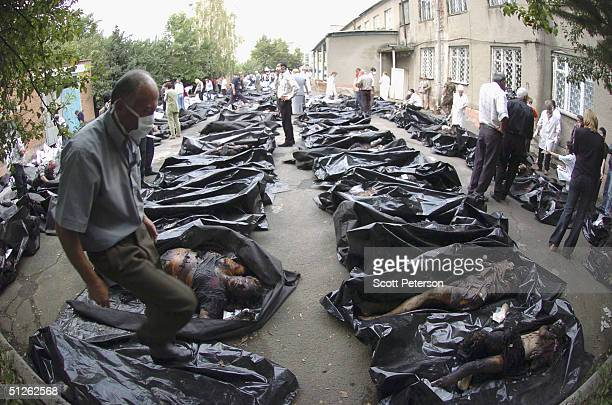 Russian relatives attempt to identify bodies of 330 known dead, the day after the three-day Russian school siege in Beslan, in which Chechen...