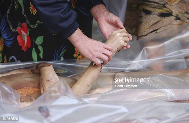Russian relatives attempt to identify bodies of 330 known dead the day after the threeday Russian school siege in Beslan in which Chechen Separatists...