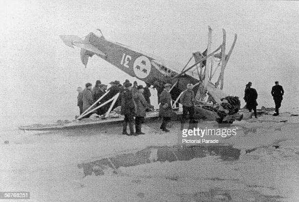 Russian rescuers inspect the downed Swedish Fokker skiplane at 'Red Tent' camp where the surviving crew of the illfated semirigid Nclass airship...