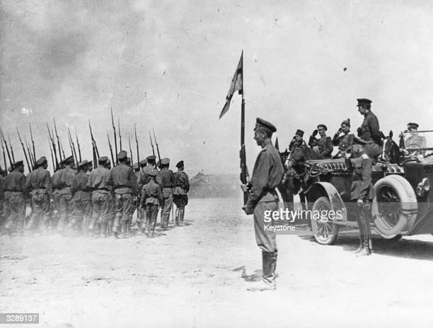 Russian revolutionary leader Aleksandr Kerensky standing in the car inspects Russian troops going to the Front during the Russian Revolution
