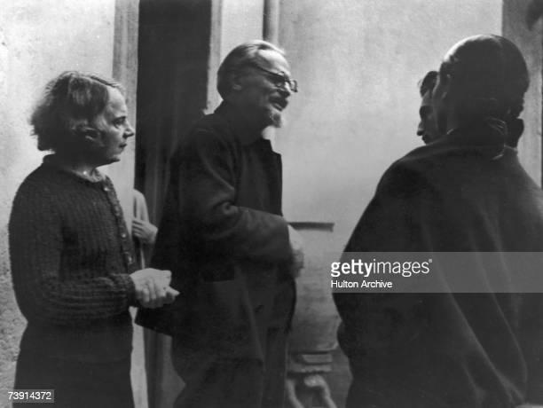 Russian revolutionary Leon Trotsky and his wife Natalia Sedova in conversation with Trotsky's secretary and hostess circa 1936