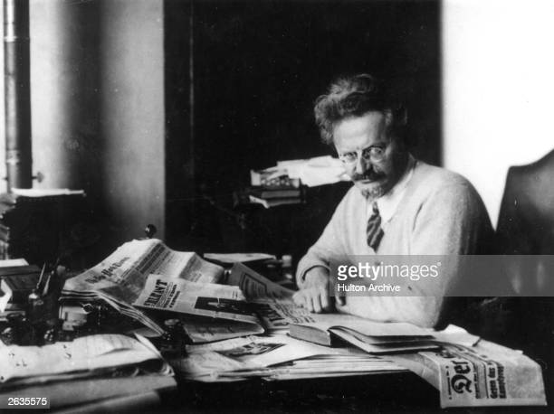Russian revolutionary Leon Trotsky working on his book 'The History of the Russian Revolution' in his study at Principe Gulf of Guinea