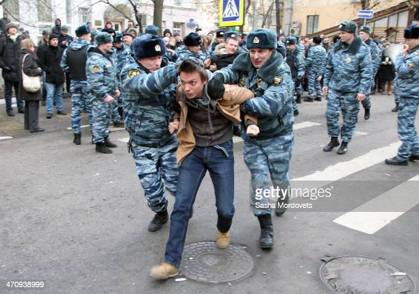 Russian riot police detain an opposition activist outside of Zamoskvoretsky District Court during an unsanctioned protest rally on February 21 2014...