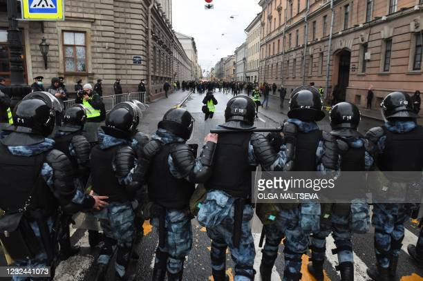 Russian riot police officers block a street during a rally in support of jailed Kremlin critic Alexei Navalny, in central Saint-Petersburg on April...