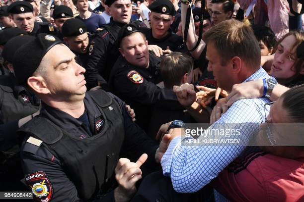 Russian riot police officers detain opposition leader Alexei Navalny during an unauthorized antiPutin rally on May 5 2018 in Moscow two days ahead of...
