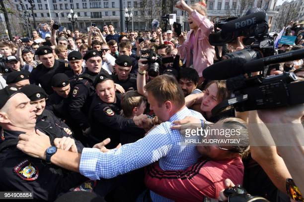 TOPSHOT Russian riot police officers detain opposition leader Alexei Navalny during an unauthorized antiPutin rally on May 5 2018 in Moscow two days...